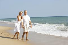 Senior Couple Enjoying Beach Holiday Stock Photos