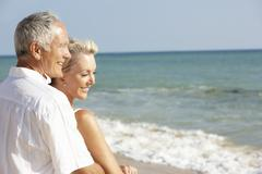 Senior Couple Enjoying Beach Holiday Stock Photos