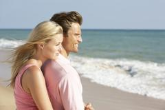 Stock Photo of Young Couple Enjoying Beach Holiday