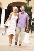 Senior Couple Enjoying Shopping Trip Together Stock Photos