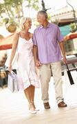 Stock Photo of Senior Couple Enjoying Shopping Trip
