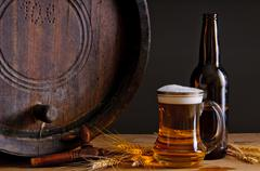 beer and wooden barrel - stock photo