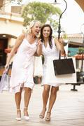 Senior Mother And Daughter Enjoying Shopping Trip Together Stock Photos