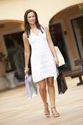 Young Woman Enjoying Shopping Trip - stock photo