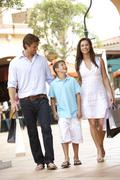 Young Family Enjoying Shopping Trip Together Stock Photos