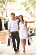 Couple Enjoying Shopping Trip Together Stock Photos