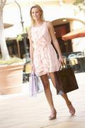 Young Woman Enjoying Shopping Trip Stock Photos