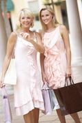Stock Photo of Senior Mother And Daughter Enjoying Shopping Trip Together