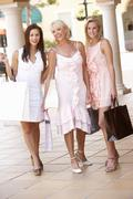 Senior Mother And Daughters Enjoying Shopping Trip Together Stock Photos