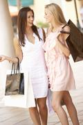Two Young Women Enjoying Shopping Trip Together Stock Photos