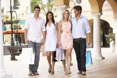 Group Of Friends Enjoying Shopping Trip Together Stock Photos