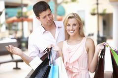 Man Frustrated With Woman On Shopping Trip Together Stock Photos