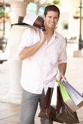 Young Man Enjoying Shopping Trip Stock Photos