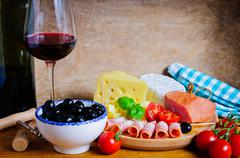 Olives, cheese, ham and wine Stock Photos