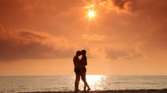 Teen couple in love on the beach Stock Footage