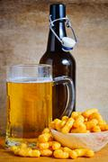 beer and peanut curls - stock photo