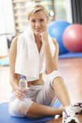 Woman Resting After Exercises In Gym - stock photo