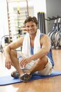 Man Resting After Exercises In Gym - stock photo