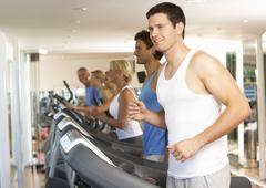 Man On Running Machine In Gym - stock photo