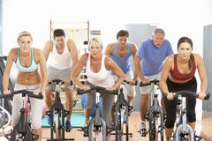 Group Of People In Spinning Class In Gym - stock photo