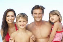 Portrait Of Family On Summer Beach Holiday - stock photo