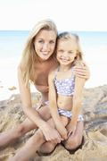 Portrait Of Mother And Daughter On Summer Beach Holiday Stock Photos