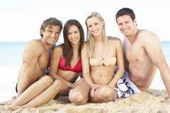 Group Of Friends Enjoying Beach Holiday Stock Photos