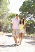 Young couple, holding hands, walking,walk in park Stock Photos