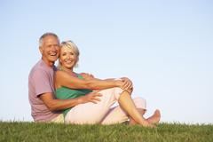 Senior couple posing on a field Stock Photos