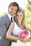 Portrait Of Bridal Couple Outdoors Stock Photos