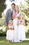 Bride And Groom With Bridesmaid At Wedding Stock Photos