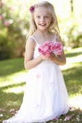 Portrait Of Bridesmaid Holding Bouquet Outdoors Stock Photos