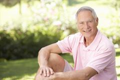 Senior man relaxing in a park - stock photo