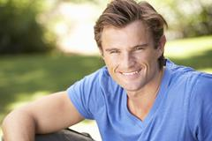 Portrait Of Young Man Relaxing In Park - stock photo