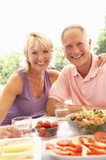 Senior couple eating outdoors Stock Photos