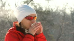 Girl in sunglasses  with thermos wood  winter drinks hot tea (coffee) Stock Footage