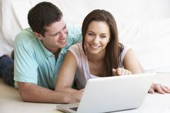 Young couple on laptop computer Stock Photos