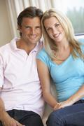 Young couple posing indoors - stock photo