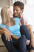 Young couple posing indoors Stock Photos