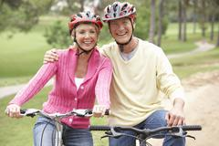Stock Photo of Senior couple riding bicycle in park