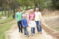 Three Generation Family enjoying walk in park Stock Photos