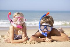 Young children on beach holiday Stock Photos