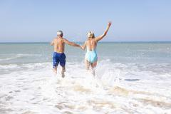 Senior couple on beach holiday Stock Photos