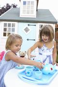 Two young girls play outdoors Stock Photos
