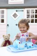 A young girl plays outdoors Stock Photos