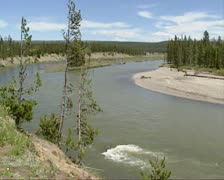 Snake River with sediment deposits on river bank - stock footage