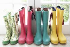 A display of colorful rain boots Stock Photos