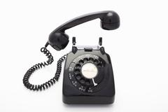 A rotary dial telephone - stock photo