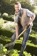 Young man working in garden Stock Photos