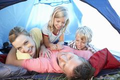 Young family playing in tent Stock Photos